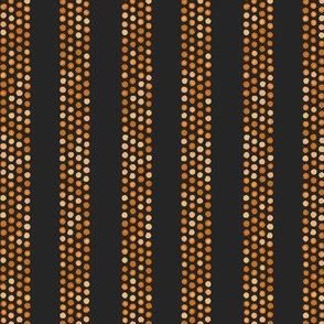 Dots and stripes in orange and black