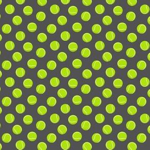 (extra small scale) tennis balls on dark grey