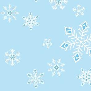 large - snowflakes on light blue