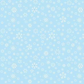 small - snowflakes on light blue