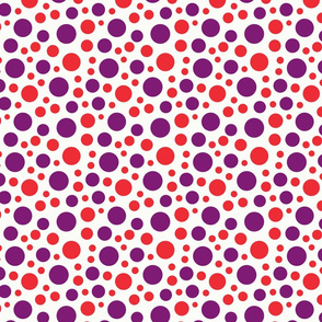 Red and purple dots of different sizes over beige background