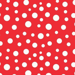 Beige circles of different sizes over red background seamless pattern