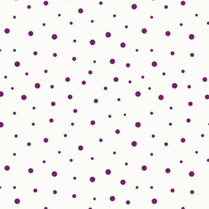 Purple dots of different sizes over beige background seamless pattern