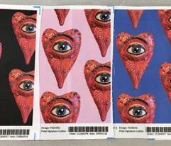 folk art heart with eye, black red blue