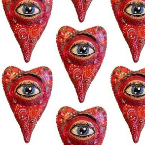 folk art heart with eye, white red blue