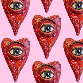 folk art heart with eye, red pink blue