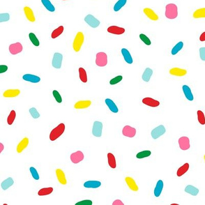 Sweet glazed, with colorful sprinkles on white melting icing seamless pattern