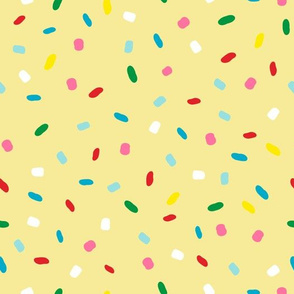 glazed with colorful sprinkles on yellow melting icing seamless pattern