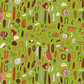Charcuterie platter on green