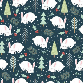Winter rabbit in the forest with Christmas trees