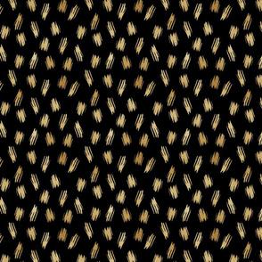 Golden paint strokes on black
