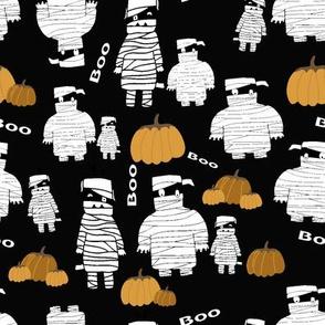 Funny Halloween pumpkins and mummies