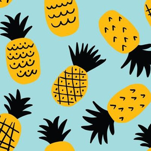 Cute hand drawn pineapples on light-blue background