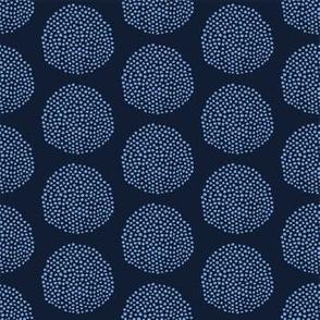 Indigo blue hand drawn seed circle pattern.