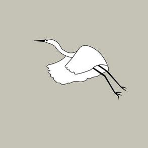 Flying white herron