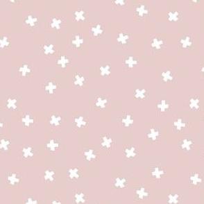 Geometric white cross stars on dusky rose pink
