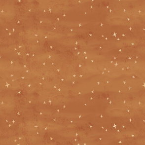Scattered gold metallic stars on copper texture