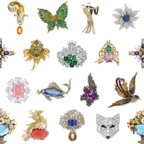 Jeweled Brooches on White