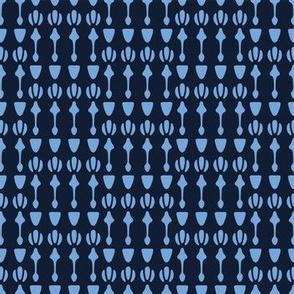 Indigo blue geometric ornamental arrow pattern.