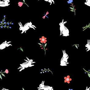 Cute bunnies on a flower field