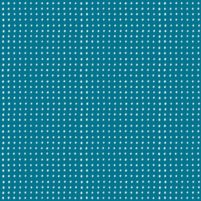 White dots on mosaic blue