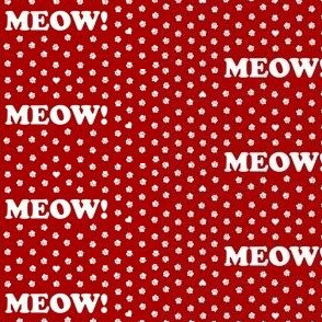 A big MEOW and little cat paws on red