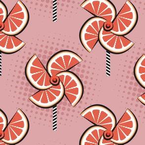 Normal scale // Pop art orange fan blowers // blush pink background orange fruits