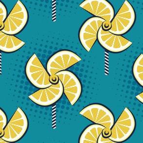 Normal scale // Pop art lemon fan blowers // teal background yellow fruits