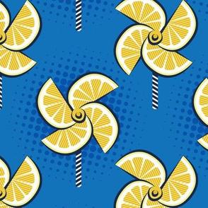 Normal scale // Pop art lemon fan blowers // denim blue background yellow fruits