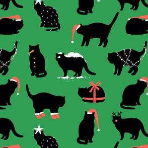 Holiday black cats. Snowman, Santa Claus, Christmas tree, a gift.