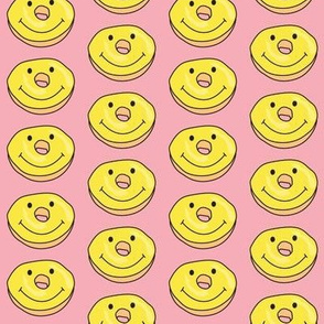 smiley face donuts on pink
