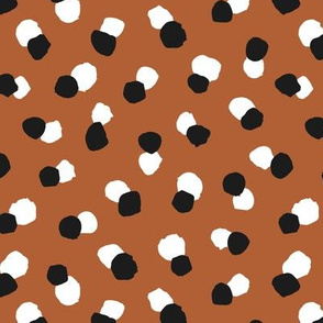 Abstract spots and dots abstract animal print trend design black and white rust copper