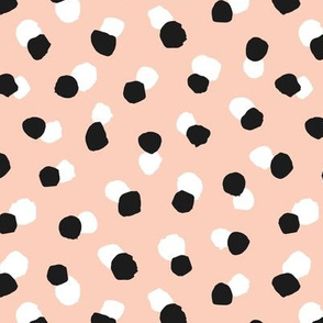 Abstract spots and dots abstract animal print trend design black and white apricot blush