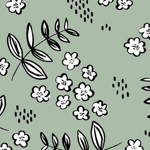 Delicate flower garden and lush green leaves and poppy seeds sage green