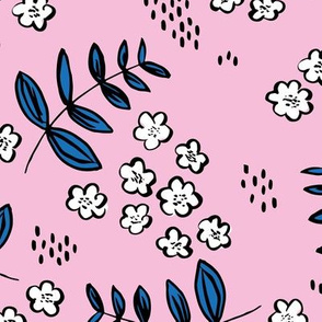 Delicate flower garden and lush green leaves and poppy seeds pink classic blue