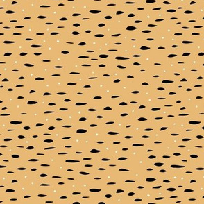Minimal animal print inspired texture ink design trend spots and speckles honey yellow