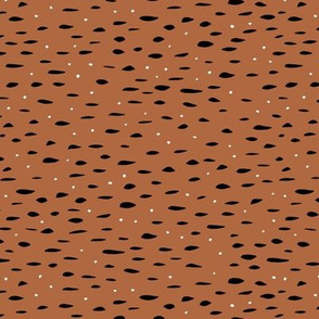 Minimal animal print inspired texture ink design trend spots and speckles rust copper brown