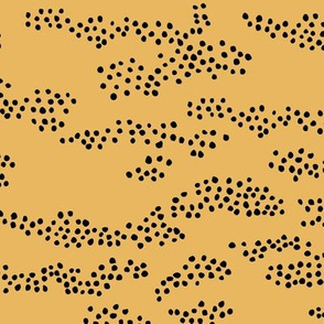 Minimal animal print snake skin inspired texture ink design trend spots and speckles abstract ochre yellow