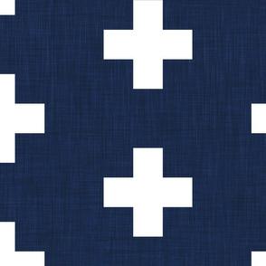 extra large white swiss crosses on navy blue linen