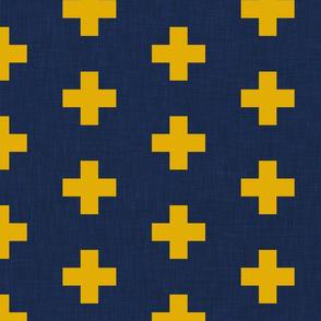large mustard yellow swiss crosses on navy blue linen