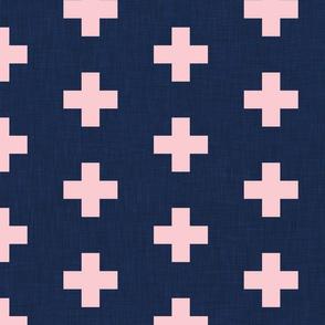 large pastel pink swiss crosses on navy blue linen