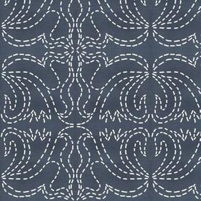 stitches on indigo linen