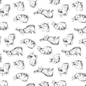 rotated // sketched rabbits on white background simple easter