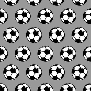(small scale) soccer balls on grey - sports balls - LAD19