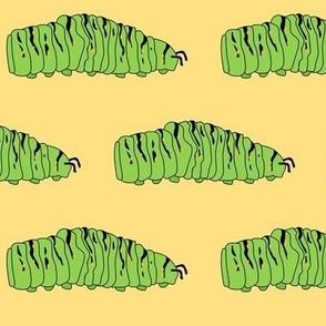 Caterpillar - micro on yellow