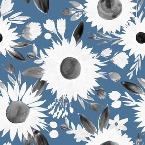 white and black sunflowers on blue