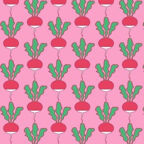 symmetrical red radishes on pink