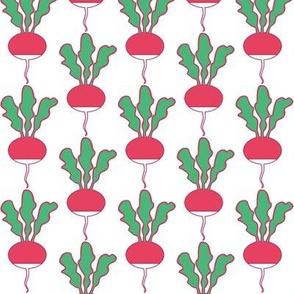 symmetrical red radishes on white