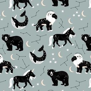 Little kawaii sleepy zodiac signs midnight moon and stars horse whale bear and lion constellation universe design pastel eucalyptus green