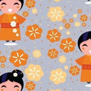Asian Girl in Orange Blossoms on Grey